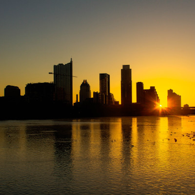 The sun rising over the Wells Fargo building in Austin, TX in February 2013. Photo via wikipedia.