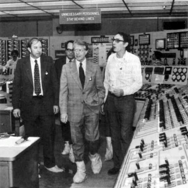 Jimmy Carter touring the failed reactor control room wearing safety boots.