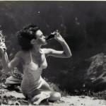 Mermaid drinking underwater