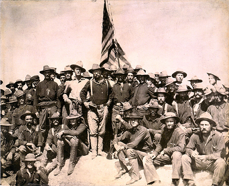 """Colonel Roosevelt and his Rough Riders at the top of the hill which they captured, Battle of San Juan"""