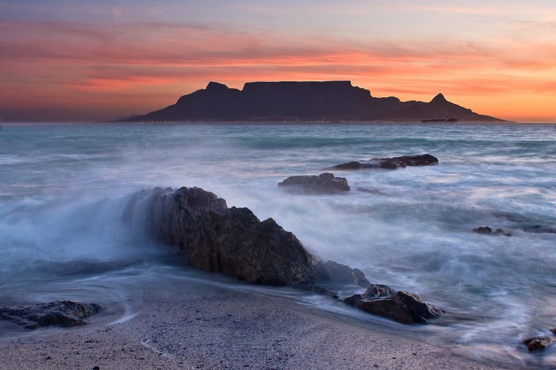 The colors of Table Mountain at sunset with large rocks