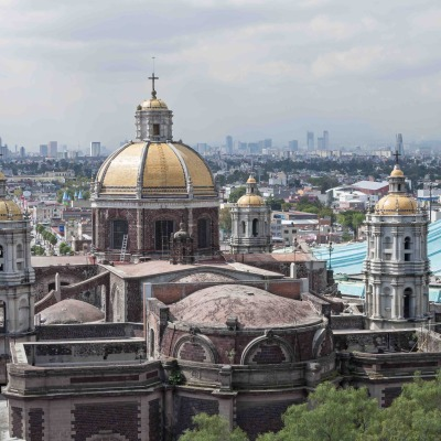 Basilica and skyline of Mexico City
