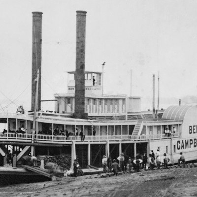 A historic picture of a steam paddleboat.