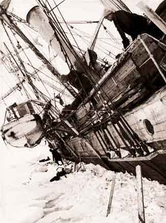 Shackleton looking overboard at Endurance being crushed by the ice. Photo via Wikipedia.