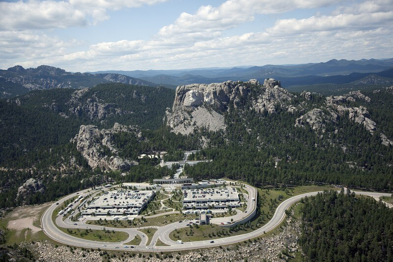 Mount Rushmore Aerial. Mount Rushmore National Memorial, near Keystone, South Dakota, is a monumental granite sculpture by Gutzon Borglum (1867Ð1941), located within the United States Presidential Memorial that represents the first 150 years of the history of the United States of America with 60-foot sculptures of the heads of former United States presidents.